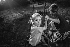 kids playing on a tire swing by Tamryn Jones