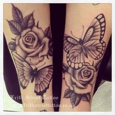 The roses in this tattoo are beautiful and the butterfly I love it