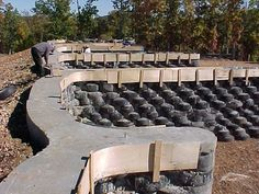 earthship home using old tires. The concrete wall cap is being installed in this photo - Google Search