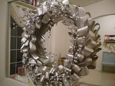 Corn husk wreath....was used for fall, then spray painted silver for Christmas....add some sprays...and viola!