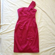 """Julian Joyce one shoulder cocktail dress Sz 4 Beautiful bright fuchsia cocktail dress. Lots of interesting design lines and pleats. One shouldered design. Right shoulder comes with detachable clear strap. Small stain pictured. Otherwise in great condition!! Pit to pit 16"""" length 33"""". Side zipper. 96% polyester, 4%stretch. Julian Joyce made by Mandalay  Dresses"""