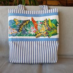 All natural eco-friendly everyday tote bag featuring hand stitched cross stitch panel, silk lining and side pocket by KindredClassics on Etsy Seat Covers For Chairs, Eco Friendly Bags, Needlepoint Kits, Save The Planet, Green Stripes, Hand Stitching, Floral Design, Cross Stitch, Butterfly