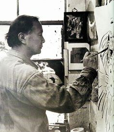 Chinese-American artist Walasse Ting works on a painting at his studio in the United States.