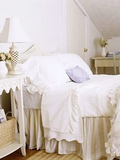 This is my perfect relaxing bedroom. The white ruffled sheets with a bed skirt just complete this look. The little lavender pillow on the pillows brighten this white bedroom.