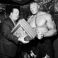 Paul Heyman with Universal Champion: Brock Lesnar as Men's MITB Briefcase Seth Rollins, Wwe Money, Paul Heyman, Wwe Pay Per View, Wwe Champions, Money In The Bank, Brock Lesnar, Raw Women's Champion, Wwe News