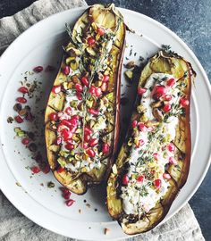 changing things up and cooking dinner with the family tonight (we usually go to a big party) and i'm really looking forward to the extra few hours of quiet time with my sister, mother and father before the madness of tomorrow ensues 🙏🏻 on the menu tonight: roasted eggplant with thyme, homemade cashew probiotic yogurt, pomegranate, and pistachios. plus lots of kombucha cocktails and sushi. directions for the eggplant: cut the eggplant in half, lengthwise. score diagonally with a pairing…