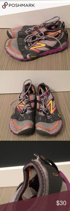 New Balance Trail Running Shoes Vibram soles. Zero drop trail running shoes. Gently used and still in good condition. The one flaw is shown in the pictures. These shoes are great for anyone looking for a running shoe with a wide toe box. New Balance Shoes Sneakers