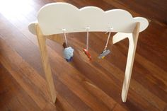 Weather themed wooden baby gym.