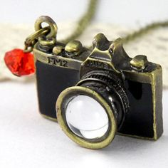 """Snapshot Locket  by Sevinoma, 39% off (""""The brass camera pendant opens to reveal a compartment for displaying a small picture, while a delicate crystal charm adds a pretty accent. The antiqued finish adds to the timeless appeal of this piece."""")"""