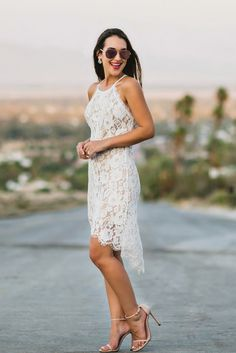 Summer's a great time to ditch your LBD for a little white dress! This white lace midi dress is the...