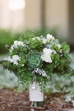 in love with this green, white and succulent bouquet