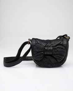 shoulder bag w/ bow.  although, i wish it were leather.