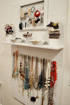 This is such a clever way to organize and display jewelry. I could see this being used to organize hair accessories as well.