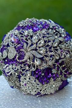 Ruby Blooms is pleased to offer you the Elite Collection - Silver Royal Purple wedding brooch bouquet. Designed for Purple Silver Wedding Bridal Flowers and Special Events! Brooch Bouquet Specificatio