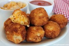 """Fried Mac & Cheese- Kiddo and adult friendly appetizer. Serve these """"bombs"""" with some marinara and you will please the whole crowd. Great for using up the leftover macaroni and cheese!"""