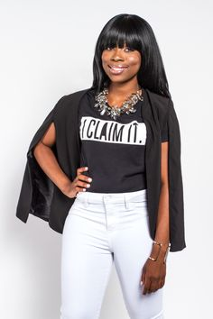 Black African American Women Queen with I CLAIM IT black and white tshirt on #iclaimitqueen #iclaimit #iclaimitqueens #claimsetter Fashion all white pants Bright smile