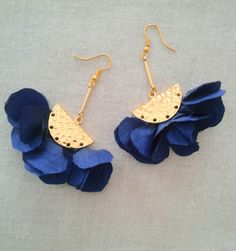 Bronze earrings with fabric flowers.