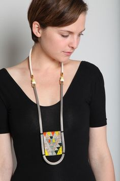 LIZZIE FORTUNATO  High Tides Necklace    PRODUCT DETAILS Graphic beaded patch necklace with silver mesh chain. White rope back and African bone bead and yellow African fulani bead detail at sides. Slips on.