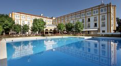 Exe Gran Hotel Solucar Sanlúcar la Mayor This hotel in Sanlucar la Mayor offers a seasonal outdoor pool, free WiFi zone and free parking. Buses opposite the hotel take 30 minutes to central Seville, or you can drive there in 15 minutes.