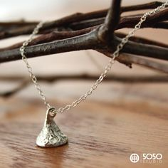 This necklace is so unique and pretty, without all the chocolate calories of a real kiss.