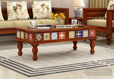 Get beautifully crafted solid wood center & tea table furniture online. Make your home more appealing with this solid wood center table designs. find the best wooden center table furniture design at Wooden STreet. Buy Coffee Table, Coffee Table Furniture, Solid Wood Coffee Table, Tea Table Design, Table Designs, Wooden Street, Center Table, Wooden Tables, Furniture Design