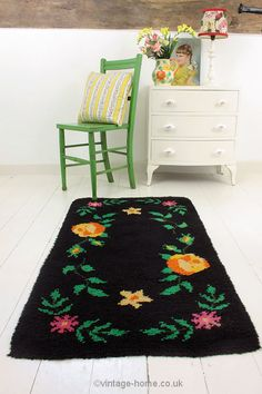 Handmade vintage folk design rug and painted chair.