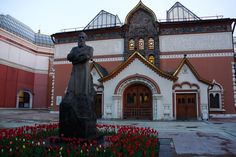 """Photo in 2017 of The Entrance to The State Tretyakov Gallery in Moscow with tulips by Photographer Artist nadysha58  & posted to """"Trip Advisor"""". It displays the Painting by Mstislav Dobuzhinsky of Tsar Peter I The Great Alexseyevich Romanov (1672- 1725 age 52) Russia studying shipbuilding in Holland."""
