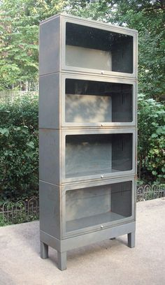 reserved for leslie vintage industrial mid century modern metal and glass bookcase barrister stackable modular distressed rusty