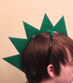 1 Dinosaur or dragon headband. These stand straight up and go down the back of…