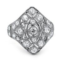 The Vanhi Ring - This gorgeous Art Deco ring in platinum is adorned with old European cut diamonds individually set in geometric shapes. Piercing milgrain fills the ring for a ravishing look from every angle (approx. 1.73 total carat weight).