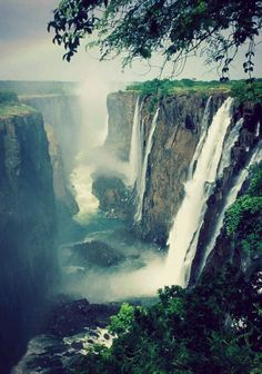 #VictoriaFalls in #Zimbabwe | The Victoria Falls or Mosi-oa-Tunya is a gorgeous waterfall, located on the Zambia and Zimbabwe border. The water of Zambezi river falls down in a straight line for 354 ft (108 m). It is wide ( 5,604 ft/1,708 m), therefore water spray raises very high and can be spotted from many kilometers away. #zimbabwe #waterfall #waterfallphotography #cascade #placestosee Travel, world, places, pictures, photos, natures, vacations, adventure, sea, city, town, country…