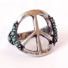 Peace symbol ring with turquoise stones. Hippie style gypsy accessories. For more follow www.pinterest.com/ninayay and stay positively #pinspired #pinspire @ninayay