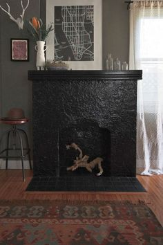 """Sneak Peek: A Seaside California Home Layered with Inspiration. """"I have had major desires for a black fireplace for some years now, so when we moved into this house, I knew it was the perfect fireplace to paint a glossy black. I love how much attention it demands in the room, as well as the way it interacts with the hardwood floor."""" #sneakpeek"""