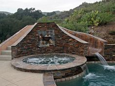 gorgeous stone slide, jacuzzi and pool built by Blue Pacific Pools, check out our website for more! http://www.bluepacificpools.com/index.html