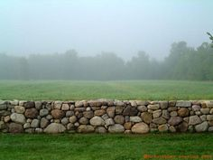 Mixed field stone wall, mixed colour and mixed sizes, mostly round