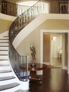 Dark wood tread, white riser, 'knee wall', wrought iron balusters, dark wooden handrail
