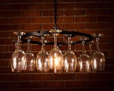 14 Wine glass Chandelier Wine glass Rack This Chandelier makes a great gift !! The Perfect Item for Any Wine Enthusiasts! The chandelier uses chain swag stylewith a 15 foot plug no wiring The cord is adjustable from 0 to 36 inches Standard Light-Bulb up to 60 W (not included) Dimensions:
