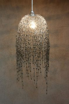 DIY safety pin lamp. I would have no where to use this, but it looks awesome.