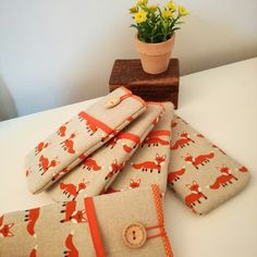 Best seller... phone pouch with foxes pattern.
