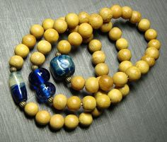 Yellow and Blue Make Beautiful Stretch Bracelets - handmade lampwork on Etsy.   LOVE the colors!