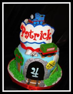 Thomas the Train themed cake, the trains are toys.