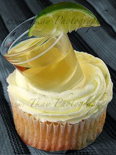 Margarita cupcake with a tequila lime butter creme & served with a shot on top. i've also served them with a green sugar and margarita salt sprinkled on top. Good way to start a Bachelorette Party