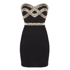 Features a solid black foundation, ultra feminine sweetheart neckline, glittering gold sequin crossover design to the front, and a sexy body-conscious silhouette to finish.
