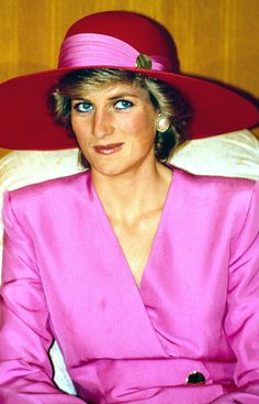 During a March 1989 official visit to Abu Dhabi, Diana Princess of Wales polished off her hot-pink double-breasted blazer with a red-and-pink wide-brimmed hat.