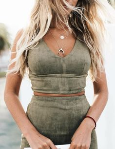 ::green suede two piece matching skirt and crop top set. love the gold jewelry too::