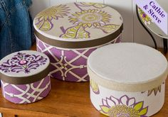 These fabric covered and stenciled hat boxes would make a lovely statement in any room, in any home.