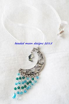 paua shell inlay, pewter charm, swarovski crystals on a handmade organza necklace ~ https://www.facebook.com/beadedmoondesigns