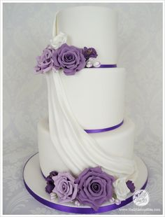 Purple 3 tier wedding cake with gumpaste flowers and drape Wedding Cakes with Purple Flowers 3 Tier Wedding Cakes, Fondant Wedding Cakes, Purple Wedding Cakes, Buttercream Wedding Cake, Wedding Cakes With Cupcakes, Cool Wedding Cakes, Wedding Cake Designs, Wedding Cake Toppers, Wedding Rings