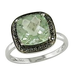 black diamond and green amethyst white gold ring.