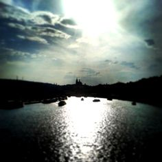 Prague Castle caught between the heaven and river.